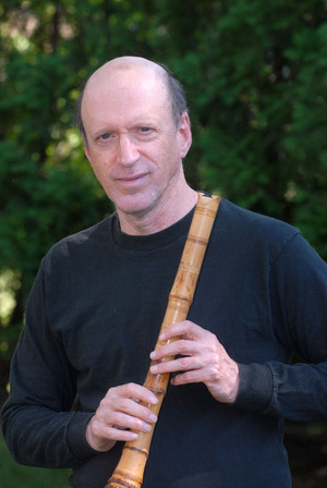 Steve Scholle plays shakuhachi in a Kol Nidre Concert